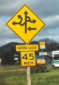 "No wonder they attached ""Good Luck"" to a regular traffic sign!  I still don't know which way to go"